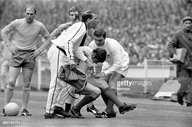 Cup Final, at Wembley Stadium, West Bromwich Albion 1 v Everton 0. Doug Fraser is helped back to his feet by assistant manager Stuart Williams and...