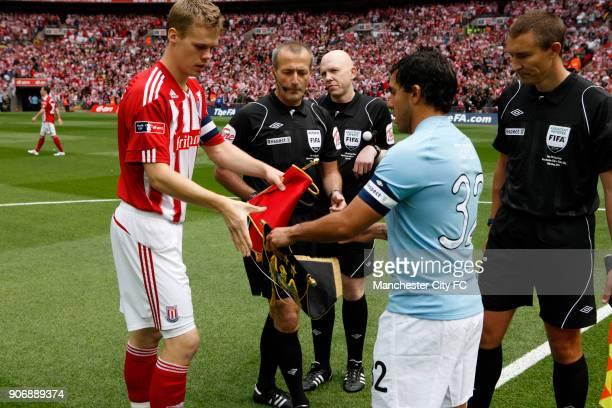 FA Cup Final Manchester City v Stoke City Wembley Stadium Manchester City captain Carlos Tevez and Stoke City captain Ryan Shawcross exchange...