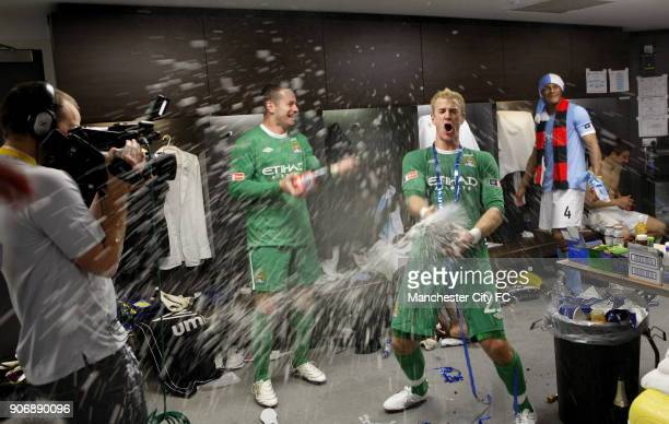 FA Cup Final Manchester City v Stoke City Wembley Stadium Manchester City goalkeepers Shay Given and Joe Hart spray champagne in the dressing room as...