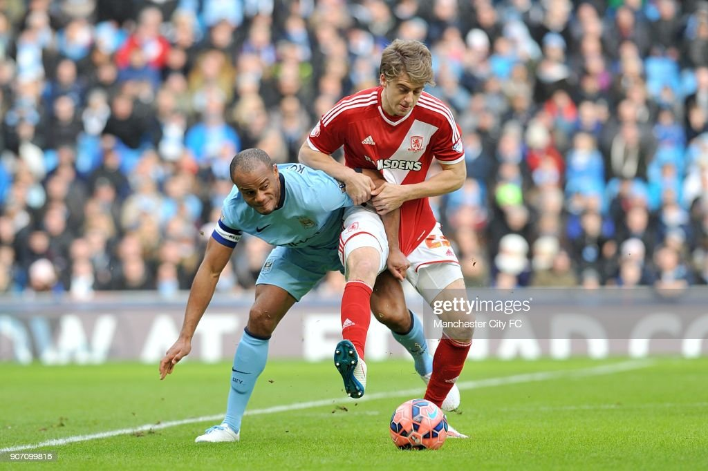 FA Cup, Fourth Round, Manchester City v Middlesbrough, Etihad Stadium, Middlesbrough's Patrick Bamford and Manchester City's Vincent Kompany (left) battle for the ball