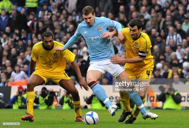 Cup, Fourth Round Replay, Manchester City v Notts County, City of Manchester Stadium, Manchester City's Edin Dzeko in action with Notts County's...