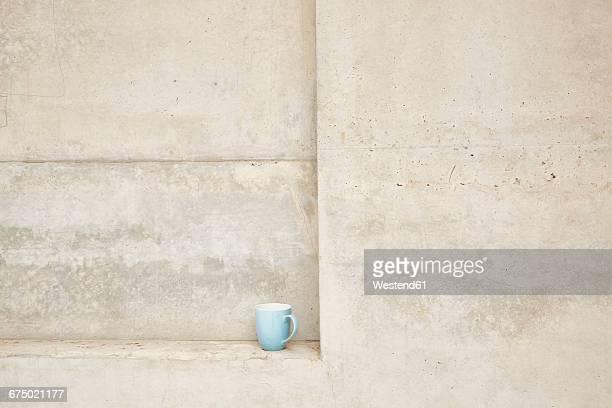 Cup in concrete ledge