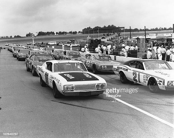 Cup machines await the start of the Dixie 500 at Atlanta Motor Speedway Cale Yarborough and LeeRoy Yarbrough occupy the front row of the grid