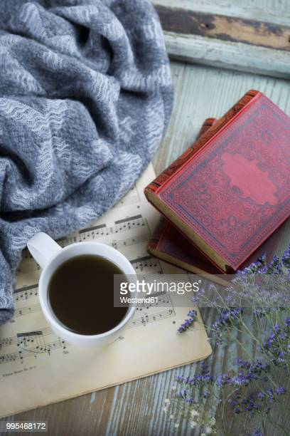 cup of black coffee, book and music sheet - hygge stock pictures, royalty-free photos & images