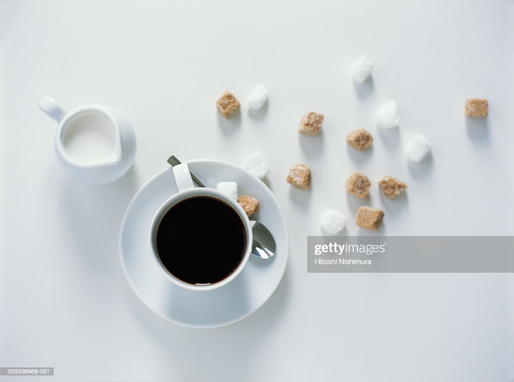 Cup Of Black Coffee Milk In Jar And Sugar Cubes Elevated View Stock