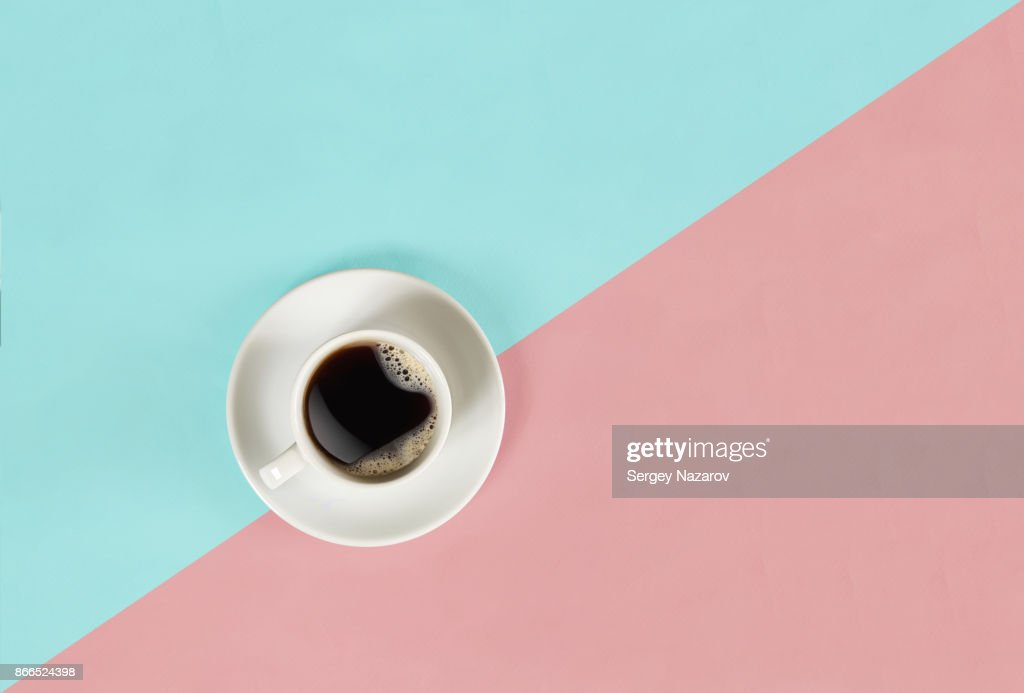 A cup of black coffee on blue and pink background. View from above : Stock Photo