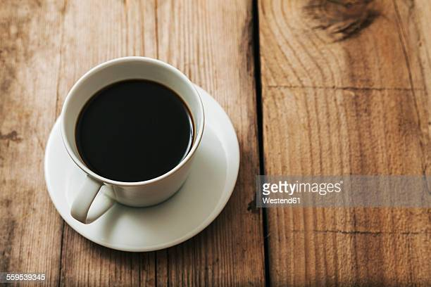 cup of black coffee on wood - saucer stock pictures, royalty-free photos & images