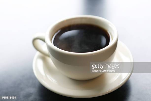 cup of black coffee - caffeine stock pictures, royalty-free photos & images