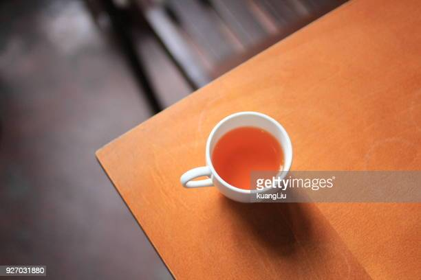a cup of black tea on corner of wooden table - corner stock pictures, royalty-free photos & images
