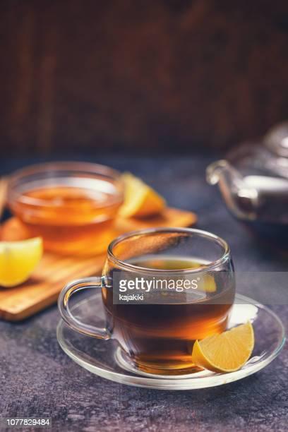 紅茶のカップ - 温かいお茶 ストックフォトと画像