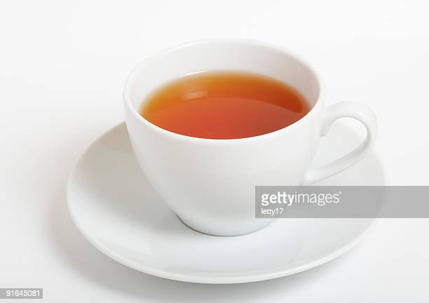 cup of black tea - saucer stock pictures, royalty-free photos & images