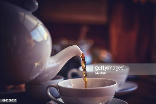 cup of black tea served with biscuits - hot tea stock pictures, royalty-free photos & images