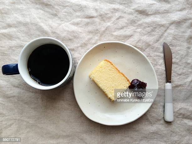 Cup Of Black Tea With Bread And Strawberry Jam