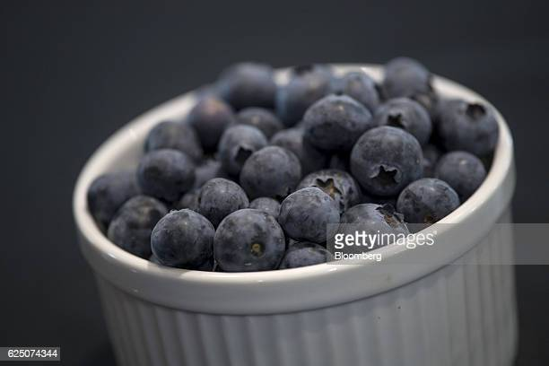 A cup of blueberries is displayed for a photograph at the Driscoll's Inc facility on the Cassin Ranch in Watsonville California US on Monday Sept 19...