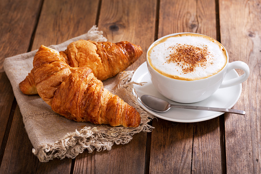 Cup of cappuccino coffee with croissants 960924058