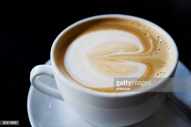 Cup of cappuccino on a white plate