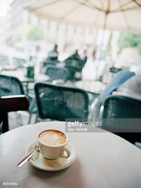 Cup of Cappuccino on cafe table
