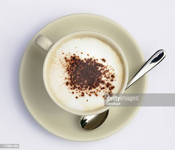 Cup of cappuccino with cacao on white background, above view