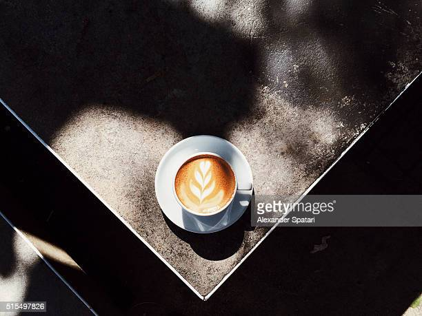Cup of cappuccino with foam latte art seen from above