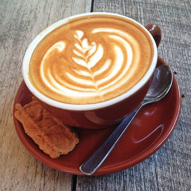 Cup Of Cappuccino With Froth Art And Cookie Wall Art
