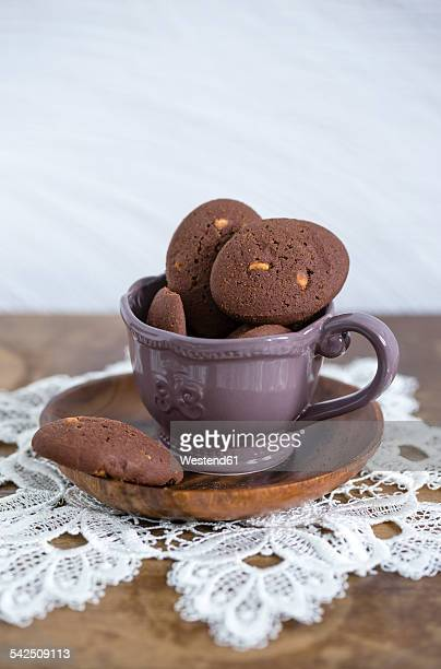 cup of chocolate cookies with chunks of white chocolate - doily ストックフォトと画像