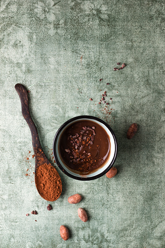 Cup of chocolate pudding with cacao, cacao nibs and cocoa beans - gettyimageskorea