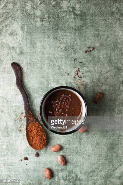 cup of chocolate pudding with cacao, cacao nibs and cocoa beans - chocolate mousse stock pictures, royalty-free photos & images