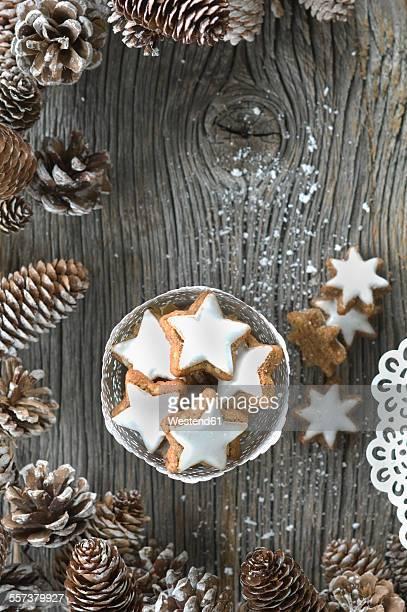 Cup of cinnamon stars and Christmas decoration