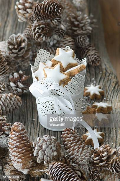 Cup of cinnamon stars and Christmas decoration