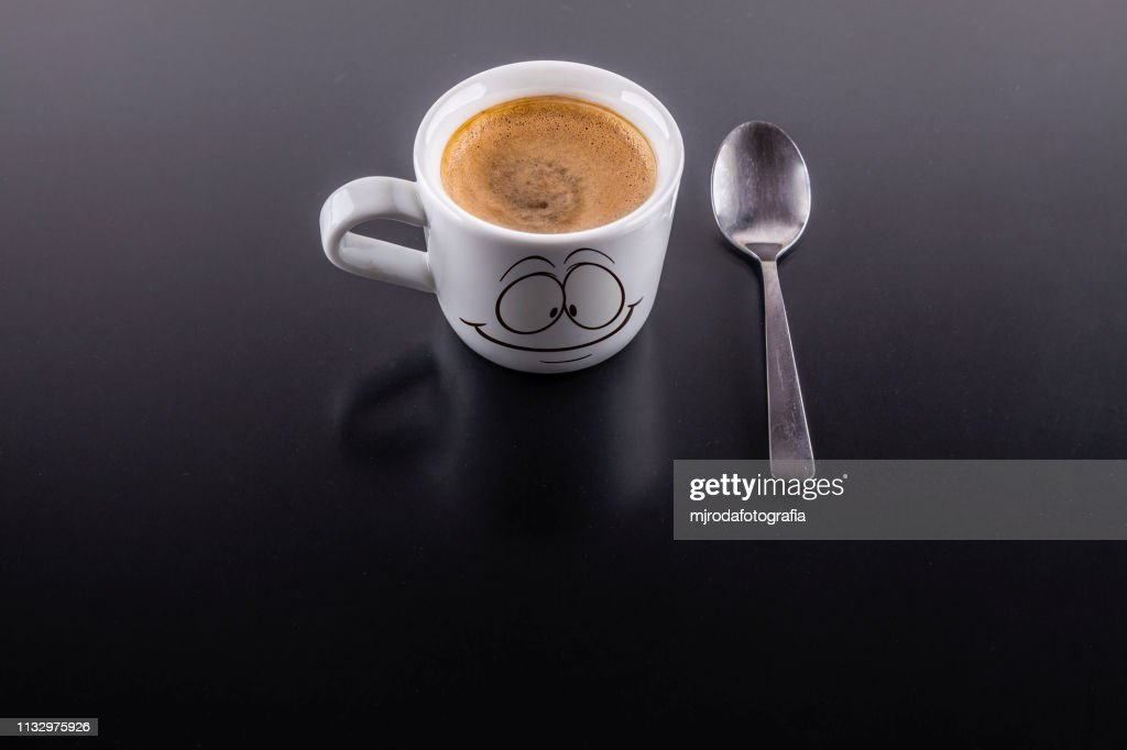 A cup of coffe with a spoon : Stock Photo