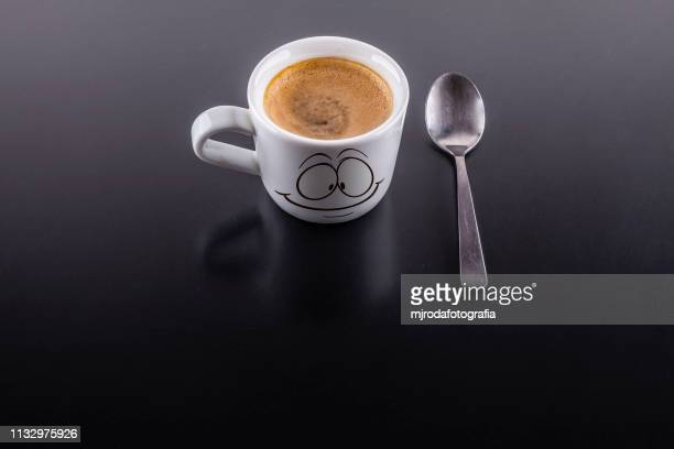 a cup of coffe with a spoon - taza de café stock pictures, royalty-free photos & images