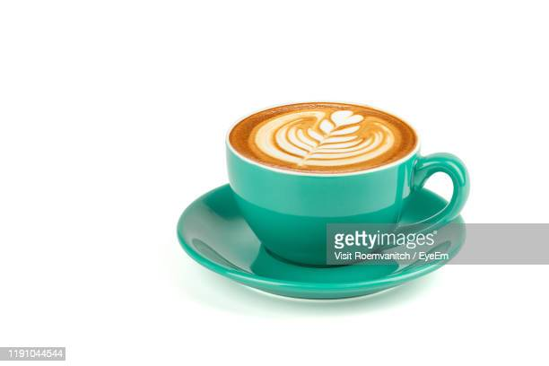 cup of coffee against white background - saucer stock pictures, royalty-free photos & images