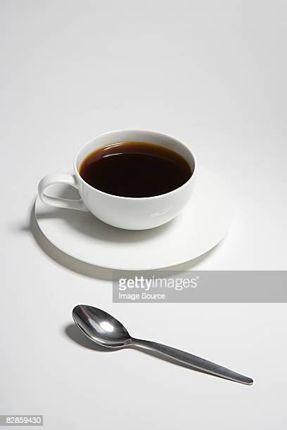 Cup of coffee and a spoon