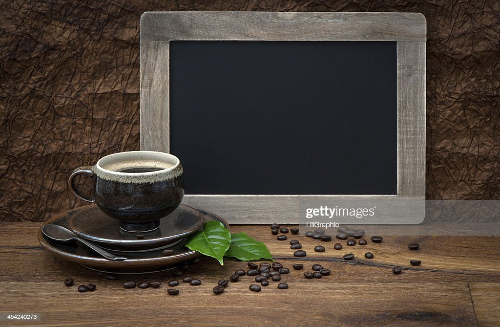 cup of coffee and antique blackboard : Stock Photo