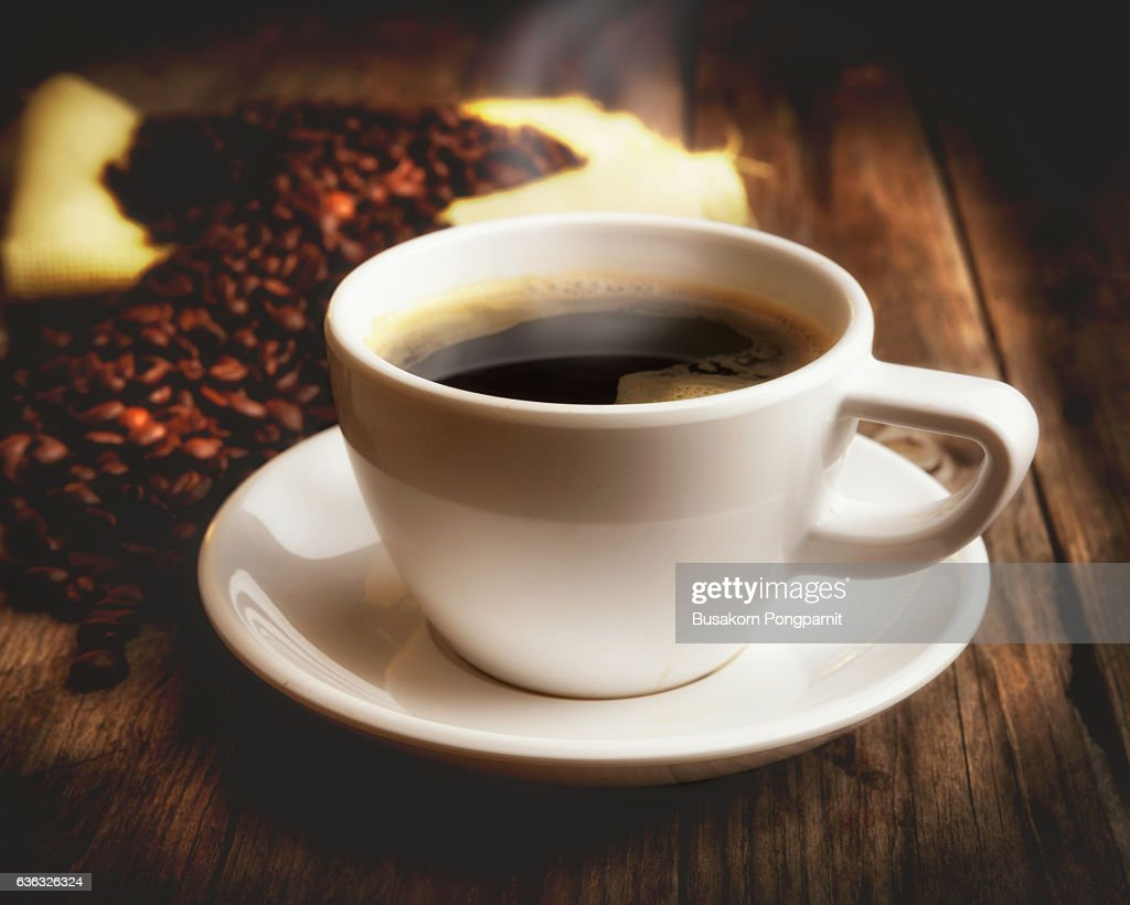 cup of coffee and coffee beans over dark background : Stock Photo