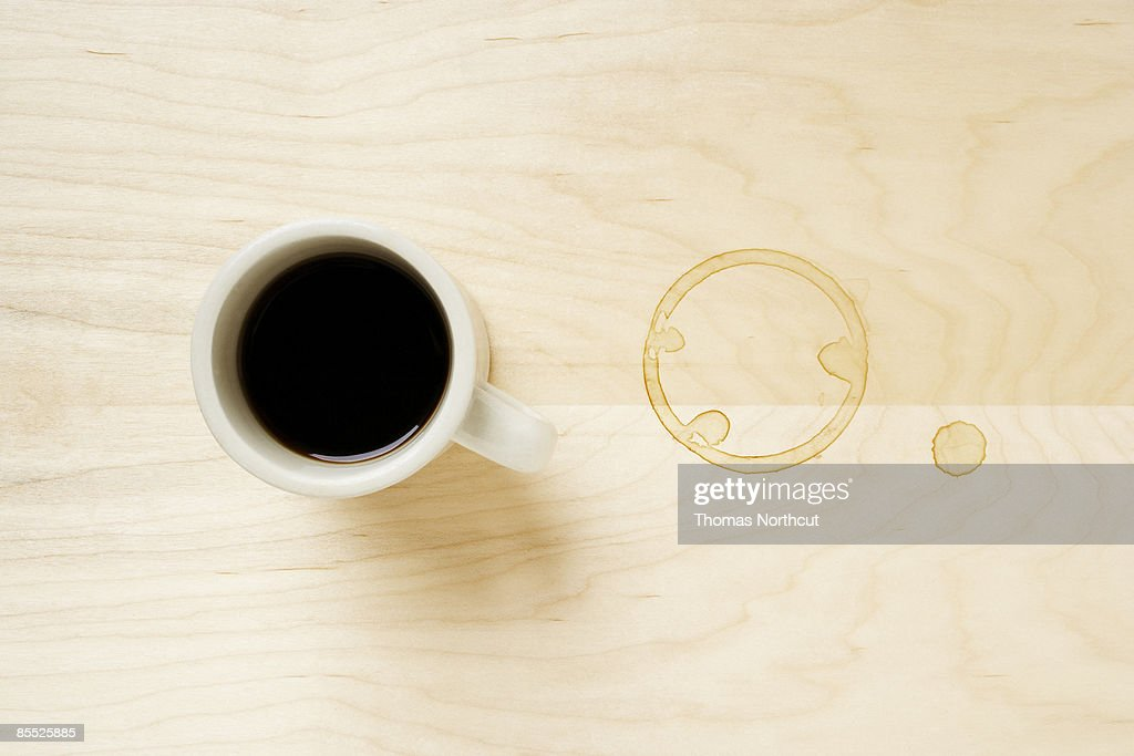 Cup of coffee and coffee ring on table. : Stock Photo