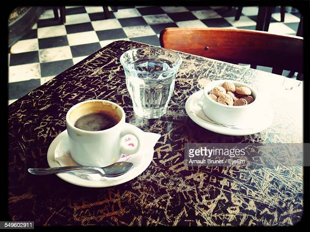 cup of coffee and cookies on table in cafe - arnault stock pictures, royalty-free photos & images
