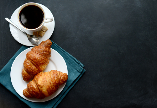 cup of coffee and croissants on black background 524528214