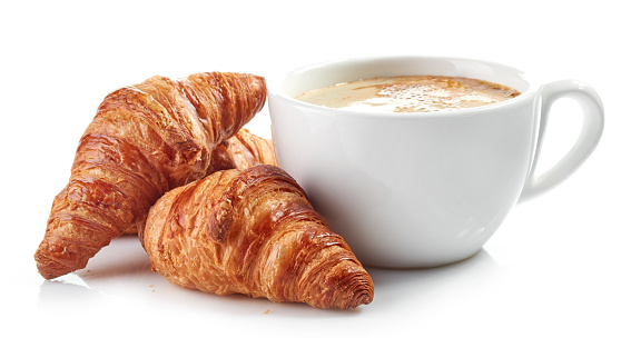 cup of coffee and croissants 674344466
