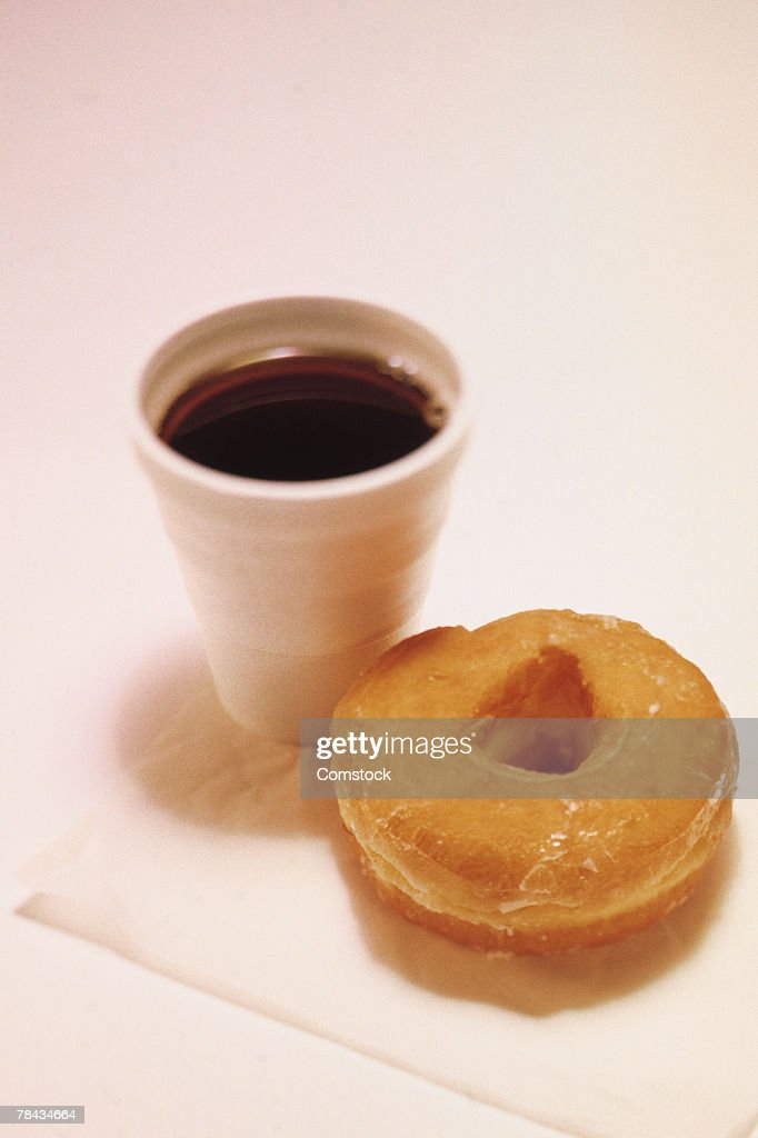 Cup of coffee and doughnut : Stockfoto