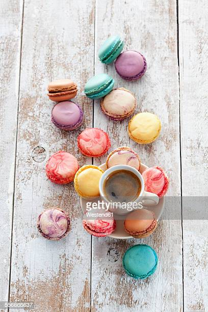 Cup of coffee and macarons on wood