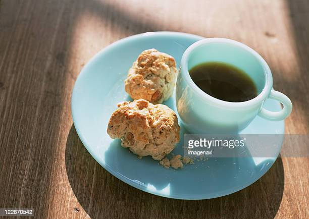 A cup of coffee and scone on dish