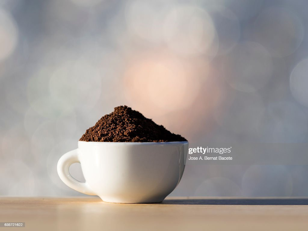 Cup of coffee espresso   it fills with a dose of ground coffee : Stock Photo