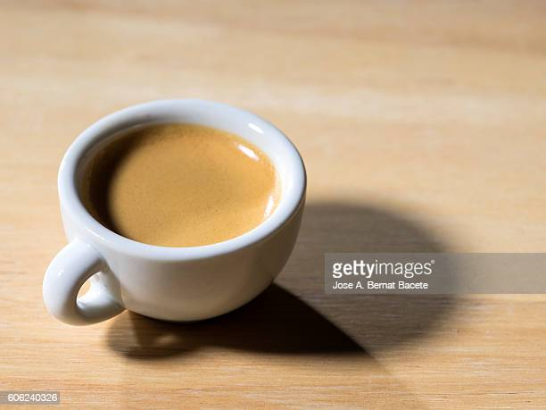 Cup of coffee espresso, on a table of wood