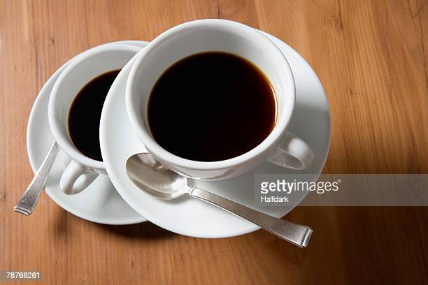 A cup of coffee floating above another cup of coffee