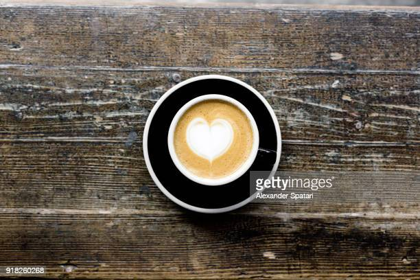 Cup of coffee high angle view with heart shape foam art