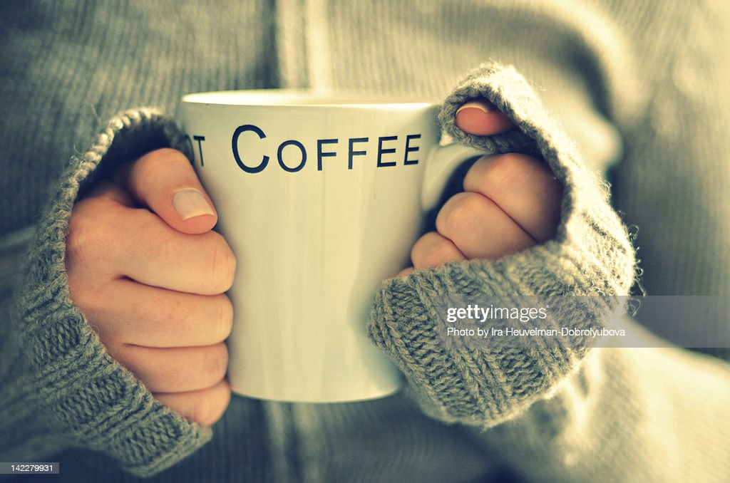 Cup of coffee in young womans hands : Stock Photo