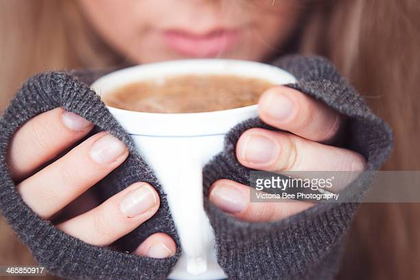 Cup Of Coffee In Young Womans Hands