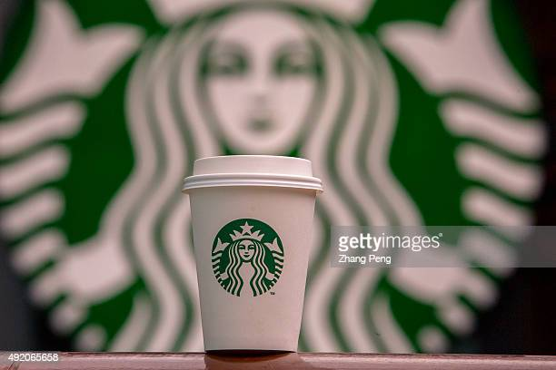 A cup of coffee is placed in front of Starbucks logo Starbucks is streamlining the ordering process so customers are able to get that cup of coffee...