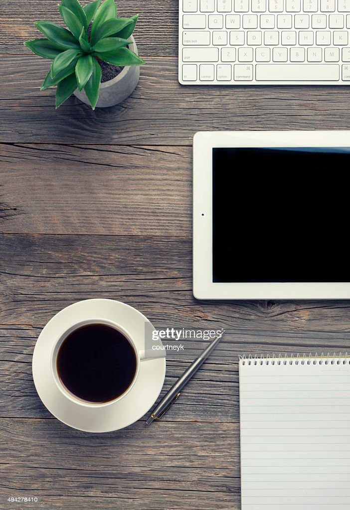 Cup of coffee , keyboard and digital tablet on wooden table. : Stock Photo